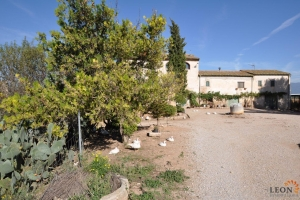 Typical Catalan farmhouse, outbuildings and worker's cottage on large terrain for sale in Llers, near Figueres, Costa Brava.