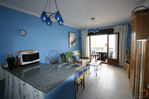 Charming one bedroom apartment for sale with communal garden and swimming pools, overlooking Lake Saint Maurici in Empuriabrava, Costa Brava, Spain.