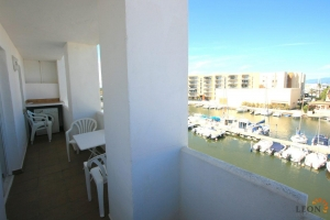 Cosy apartment with 1 bedroom, communal swimming pool and canal views for sale in Santa Margarita, Roses, Costa Brava, Spain.