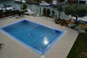 Alluring villa with 5 bedrooms, lift, swimming pool and private mooring for sale in Santa Margarita, Roses, Costa Brava, Spain.