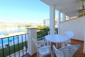 Cosy apartment in beautiful environment with two bedrooms, one bathroom, a terrace, communal pool, a garage and an extra parking place outside for sale in Empuriabrava, Costa Brava, Spain